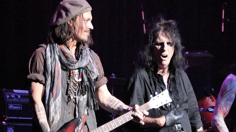 Johnny Depp played guitar with Alice Cooper and his band at Alice Cooper's 12th Annual Chrismas Pudding concert in Phoenix, Arizona on Saturday December 8, 2012.  The concert was a fundraiser for Alic